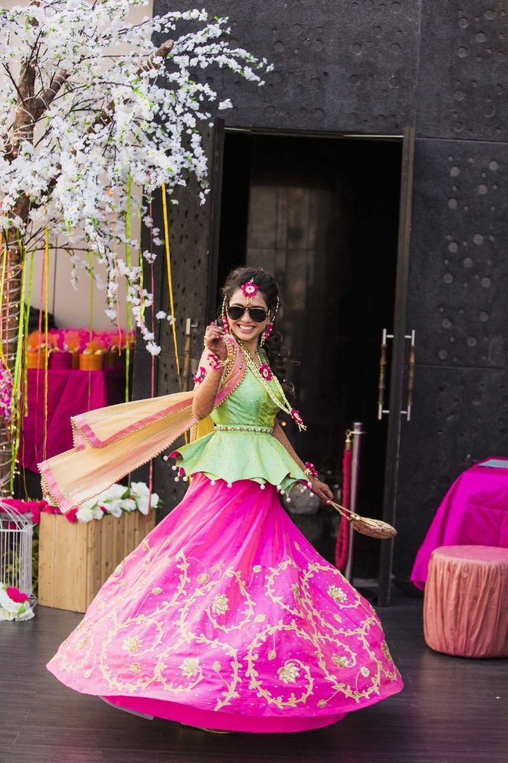 Fuchsia lehenga embellished with embroidered motifs and contrasting green scallop edged choli. | weddingz.in | India's Largest Wedding Company | Wedding Venues, Vendors and Inspiration | Indian Wedding Sangeet and Mehendi Fashion Light Lehenga |