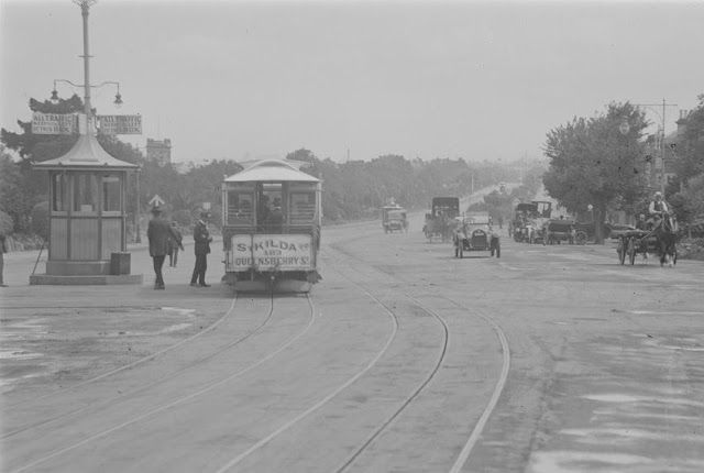 Cable tram at St Kilda Junction looking towards St Kilda Road, cable trams, cars, horse and carts and pedestrians all competed for use of the Junction. (circa early 1920s)