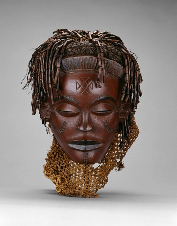 Mwana Pwo Mask, Chokwe, Angola or Democratic Republic of the Congo,   Late 19th/early 20th century    Wood, fiber, beads, and pigment  44.5 x 19.3 x 18.7 cm