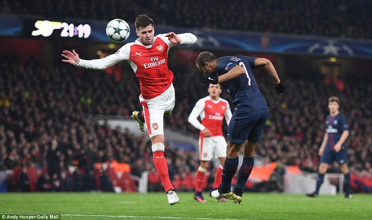Lucas Moura beats Carl Jenkinson with a header before Alex Iwobi directed it into his own net as PSG drew with Arsenal