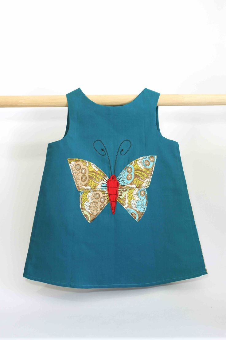 Peacock Blue Butterfly Dress: This super cute summer dress not only looks great on kids but is also comfortable to wear and easy to clean, making it perfect for all occasions and still allowing a kid to be a kid.