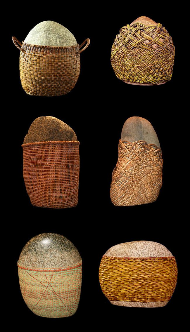 Del Webbers Art combines rough natural materials, like pebbles, with handmade basketry addidtions.
