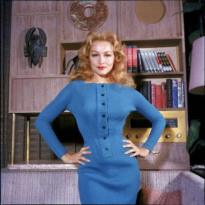 Julie Newmar vintage fashion style 50s blue sheath wiggle dress black buttons long sleeves color photo print ad movie star