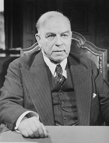Source: Photograph of Prime Minister Mackenzie King. In the late 1930s Prime Minister Mackenzie King goes to Geneva where he renounces the notion of collective security, asserting that the League's role should be one of conciliation and mediation, not punishment. In the same year, King signs a three-year, most-favored-nation trade agreement between Canada and the United States. This would form the basis for increasingly close relations between the two countries later on.