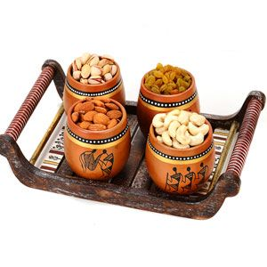Terracotta Tumblers:   Perfect hamper for the perfect occasion. Hamper includes: Tumblers with wild tribal art motifs in simple terracotta. Comes in a set of 4 pieces. Premium quality handpicked cashew, kismis, almonds and roasted pistas. Net weight: 50 grams each. Wooden tray. Size: 12 x 7 inches. Costs Rs 1835/- http://www.tajonline.com/diwali-gifts/product/d4190/terracotta-tumbler-with-tribal-motifs-and-tray-set-of-4/?aff=pinterest2013/