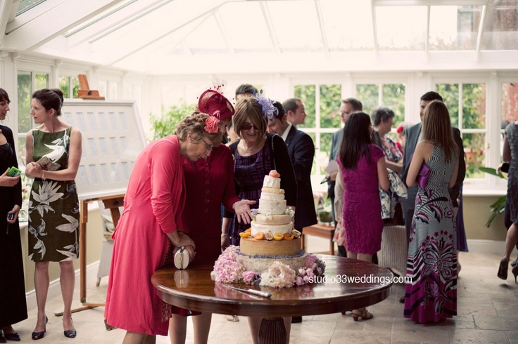 Inspecting the #Cheese Cake  http://www.studio33weddings.com/tag/ballymagarvey-village/