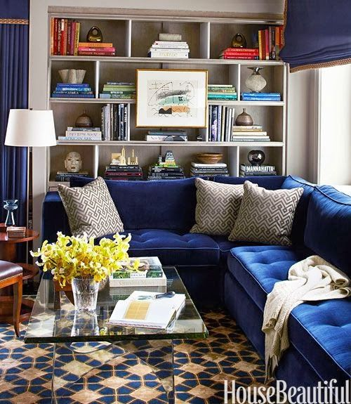 Navy velvet sofa and bookcase