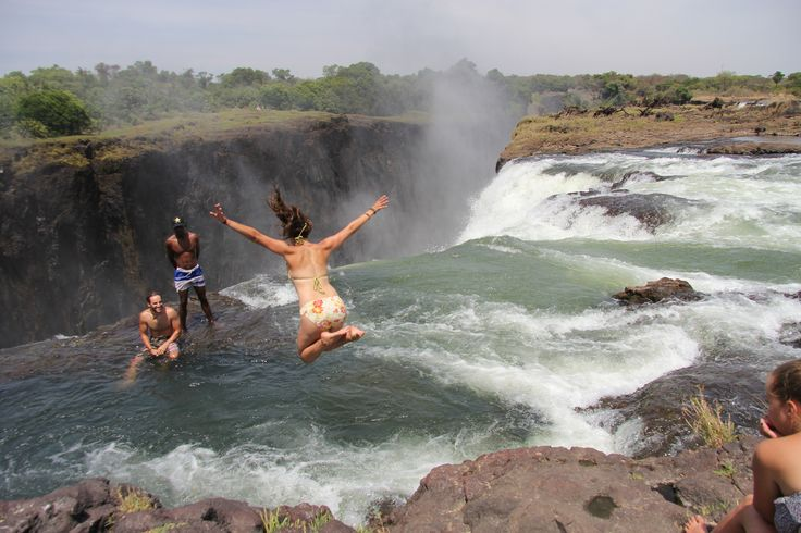 Devil's Pool offers an exhilarating swim to the edge of Victoria Falls, one of the seven natural wonders of the world. Indulge in the adrenaline rush & let CAT take care of the logistics of your luxury journey >> #LuxuryTravel #DevilsPool #VictoriaFalls 📷: Joepyrek on Flickr