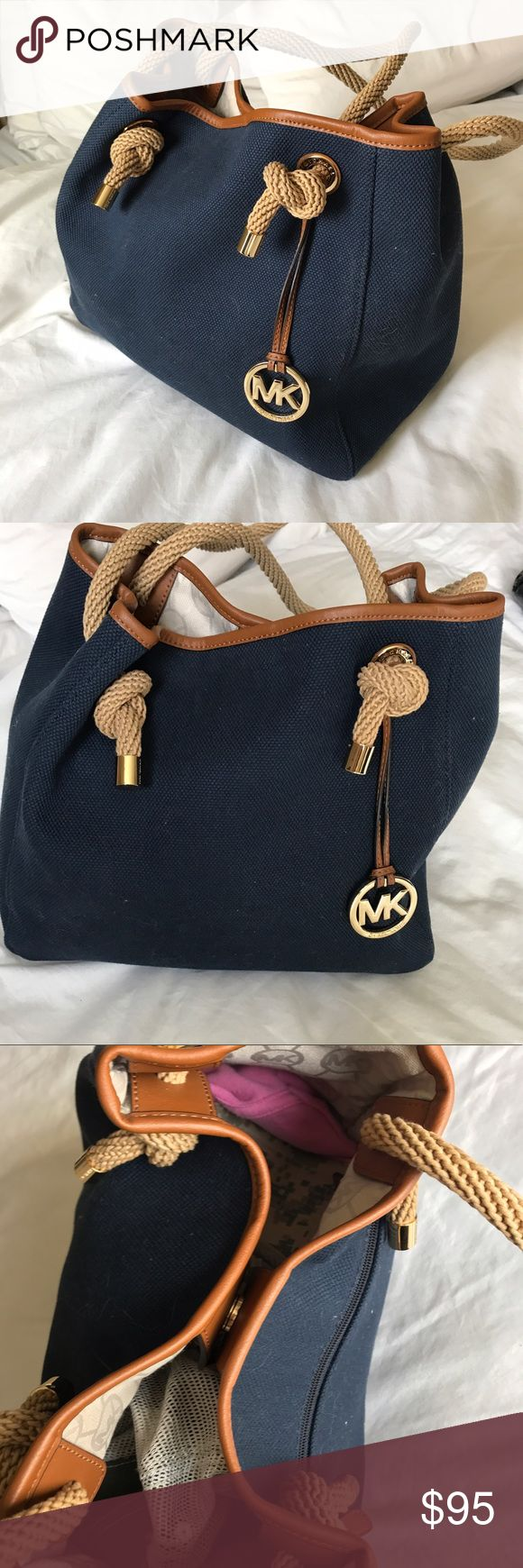 Michael Kors Nautical Purse Nautical design. Used only twice so perfect condition. I loved this bag for the Summer! Cloth fabric with knotted straps. Michael Kors Bags Shoulder Bags