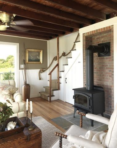 The other side of the living room reveals a fabulous wood - Living room with wood burning stove ...