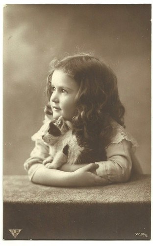 Vintage girl with kitten (real photo postcard)