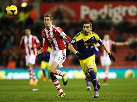 Peter Crouch during last seasons encounter with Swansea City . Stoke City v Swansea City today at The Britannia Stadium.Come on Stoke!