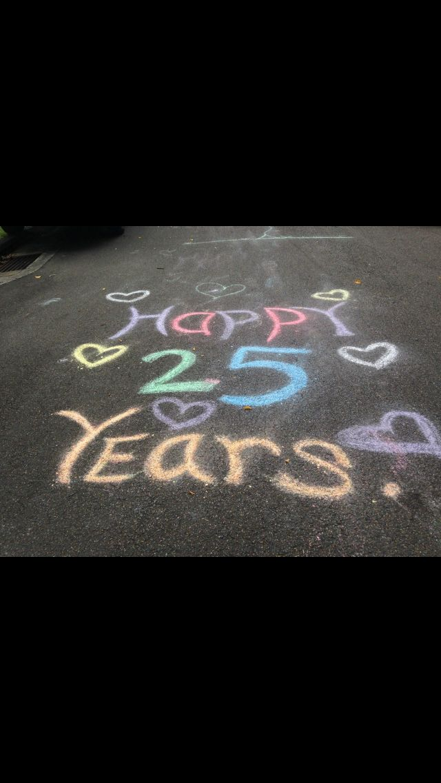 25th wedding anniversary surprise party.... Wrote with chalk on the road leading to the party, when the couple saw this on the street after returning from their walk emotions ran high. A great way to indicate the party theme/celebration whilst also being creative. Get the kids to do this job whilst you're busy setting up :)