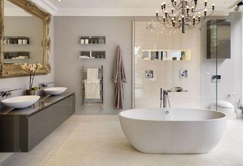 huge rococo gilt mirror freestanding bath tub and soft lavender grey walls
