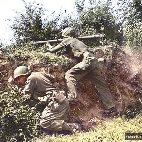 the_ww2_memoirs Two American soldiers belonging to the 315th Infantry Regiment, 79th Infantry Division, fire their M1 Bazooka at enemy positions during the long and costly battle for Normandy, Lessay, Manche, France, 18th of July, 1944. You can see one of the Bazooka team members on the left taking cover from the strong back blast that came from the M1 Bazooka after fired. This blast could kill or seriously injure you and the loaders were always told to avoid the blast and always turn with…