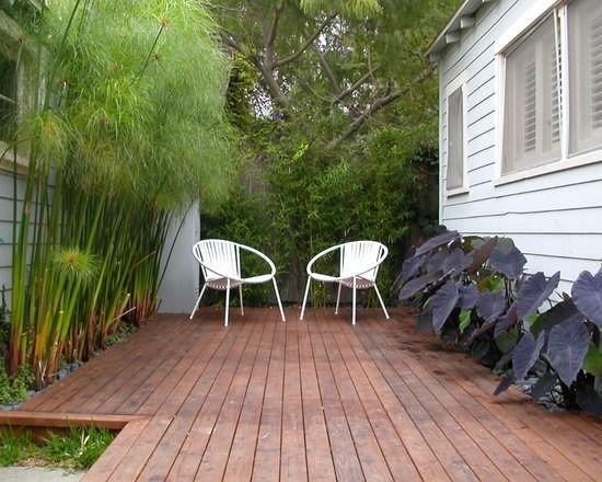 bambus sichtschutz planzen terrasse holz dielenboden sessel