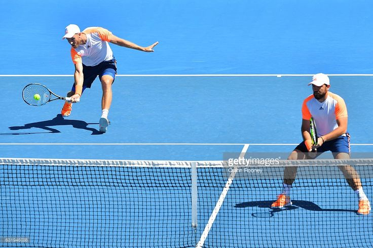 Dominic Inglot of Great Britain and Florin Mergea of Romania compete against Luke Saville and Jordan Thompson of Australia on day three of the 2017 Australian Open at Melbourne Park on January 18, 2017 in Melbourne, Australia.  (Photo by Quinn Rooney/Getty Images)