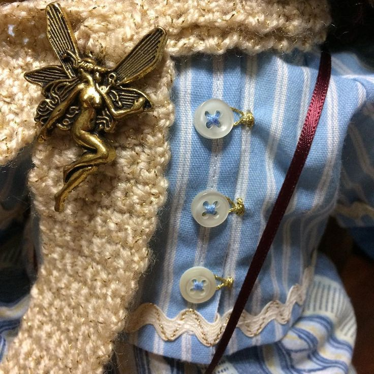 Hand crocheted scarf with a faerie amulet. Handmade blouse and skirt made from recycled clothing and fabrics.
