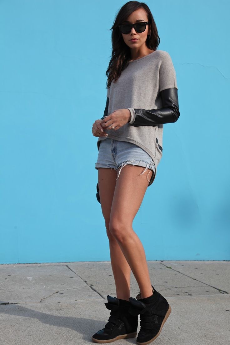 Ring My Bell  Leather sleeve sweatshirt: Courtesy of Generation Love. Shorts: Vintage Levis (alternatives here & here). Sneakers: Isabel Marant (get the look here). Bag: Alexander Wang. Sunglasses: Ray Ban.