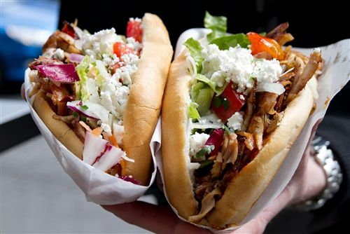 The Doner Kebab at Mustafa's Gemüse Kebap in Berlin is prepared lamb, sliced from a roasting spit, with deep fried veggies, feta cheese, lemon and sauces in bread.