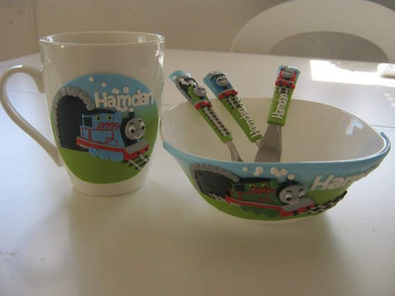 """Personalized Cutlery,Dinner set,Childrens Cutlery Set,Thomas The Train,Colored,Fork Spoon Knife with Name,Personalized,Kids Flatware    Cutlery sets contain :  Cutlery Cup and Bowl  .....  Dimension baby/toddler spoon is 15 cm (6,1"""") 0-3y  Dimension children spoon is 17 cm (6,7"""")4-10y    I custom make any words or names you desire provided the word is no longer than 8- 9 letters on one side, in any color you request.    Email me with your request and names/words needed and I will make a set…"""