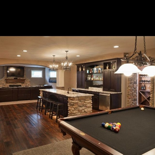 Nice rock work in this basement. Combo- media, games and bar areas I like the archway between the pool and sitting area