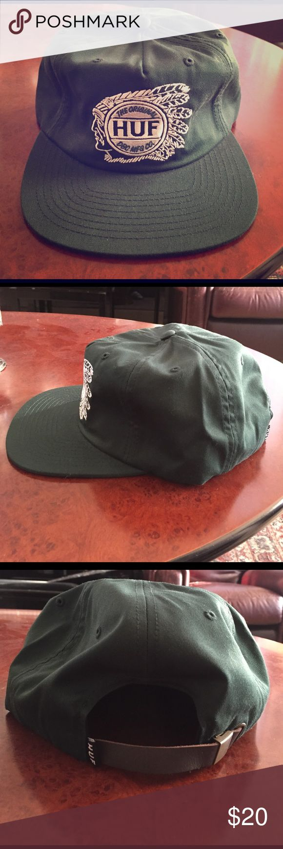 HUF hat HUF hat. Dark green with emblem at the front (Native American chief with HUF logo on top). Brown leather strap back with gold clamp and HUF logo on the other side of clamp. Made out of polyester and cotton. Great condition only worn a few times. HUF Accessories Hats