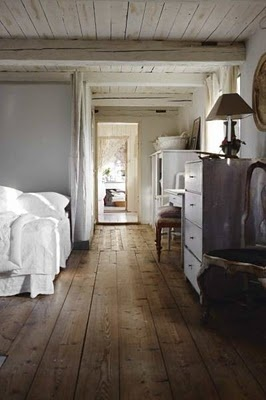 Rustic antique floors mixed with the grays and white... I just know there is a sexy cowboy outside this place!