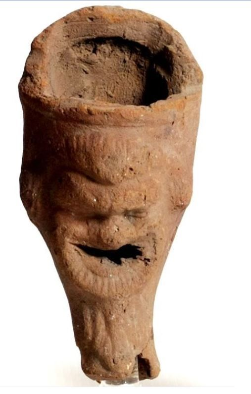 Roman terracotta incense burner with mask, 1st century A.D. Roman pottery incense burner with mask, 12.2 cm high. Private collection