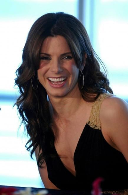 Sandra Bullock is an American actress and producer.  She is one of Hollywood's highest paid actresses.  She was born July 26, 1964 in Arlington, VA.