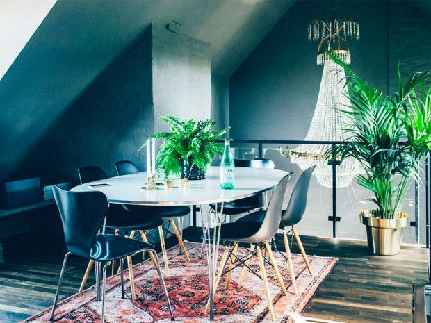 Inside an Attic Apartment With Rock 'n' Roll Style: Dark walls and eclectic artwork and accessories make for a truly unique space. via @mydomaine