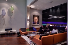 Fireplace bar area with intricately designed glass oars by Brent Kee Young and an original Chuck Close piece.: Bar Area