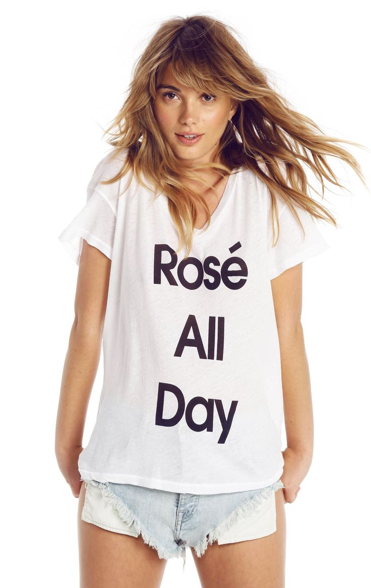 Rosé all day. This is the feeling of summer. An easy, relaxed tee featuring a v-neck and a roomy, slightly a-lined fit.  A soft and lightweight, tissue jersey blend. In Peony & Clean White. 50% Cotton, 50% Polyester  Model wears a size small.