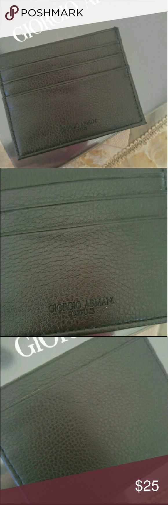 Giorgio Armani leather wallet/card holder A slim alternative to a traditional wallet, it is made from finest leather and will safely hold up to 4 cards.  Its also fits standard size business cards and has a middle compartment for bills or receipts.  It came as part of a parfum set and will come in original packaging. Giorgio Armani Bags Wallets