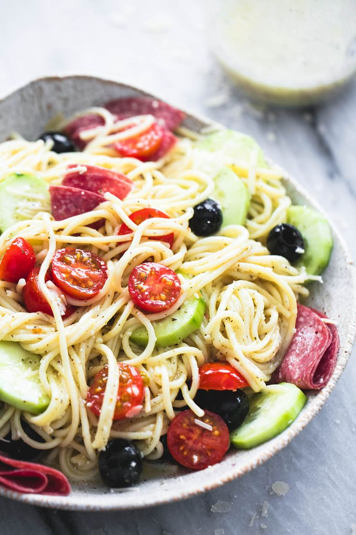 Creamy Italian spaghetti pasta salad is easy, quick, and insanely yummy - the perfect side dish for summer get togethers, barbecues, and potlucks.