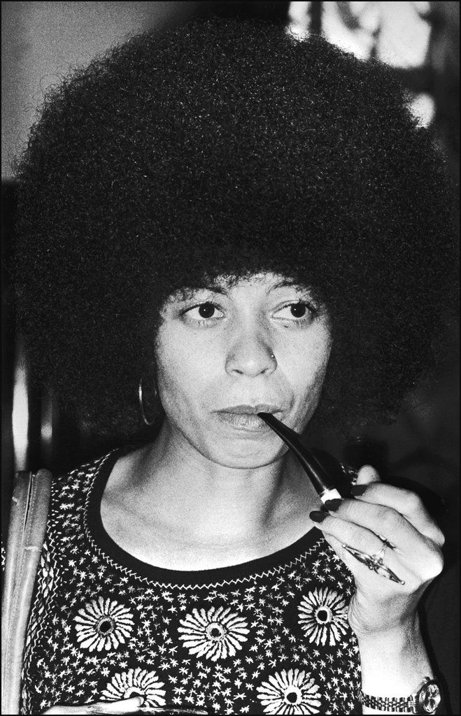 Angela Davis: Political activist Angela Davis's hair defined a generation. Her oversize Afro helped her stand out just as much as her politics did.