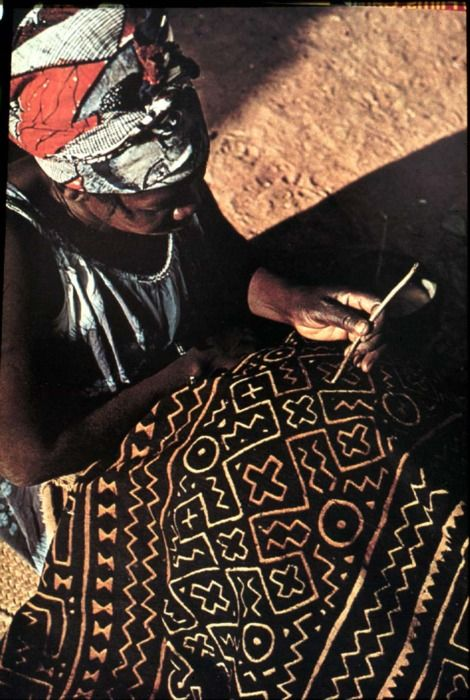 Cotton cloth dyed yellow and hand painted with mud by women.  Found in Mali.  Resist dye technique.