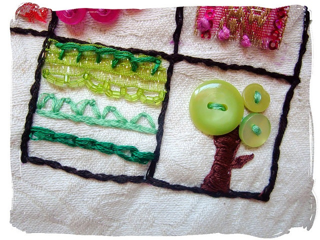 Stitched tree using a few green buttons. LOVE IT!