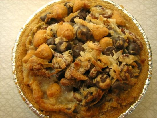 "Hill Country Chicken's Cowboy Pie - Also Recipes For Their Classic Pumpkin Pie, Bourbon Whipped Cream, Double Nut Pecan Pie, and Cherpumple ""Monster"" Pie Cake."