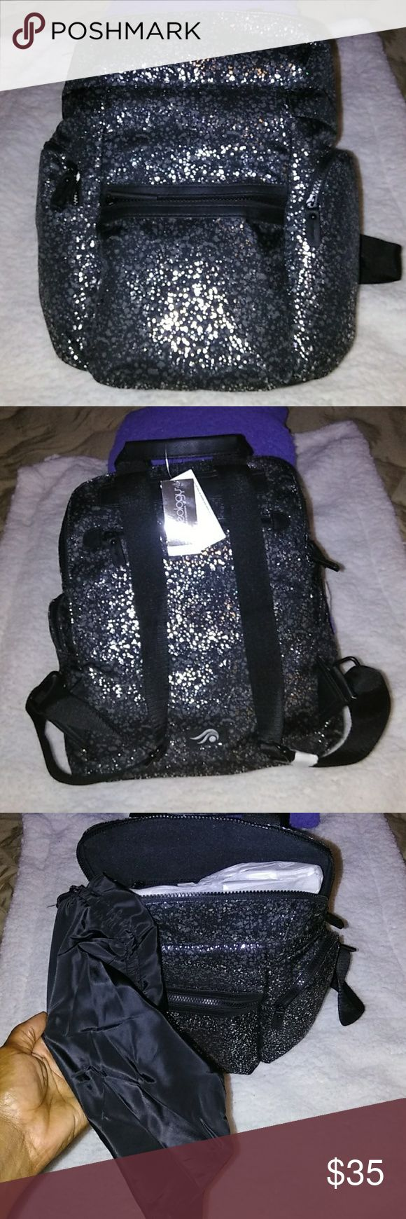 IDEOLOGY CUTE BACKPACK 😍 Perfect, black and silver backpack, front zip pocket, 2 side zip pockets for water bottle, Bonus drawstring shoe pouch for shoes, inside zip pocket, inside 2 slit pocket for cell phone, back zip pocket.  Bundle and Save! $3.99 shipping for the first Shopper! Free gift with any Purchase! Ideology Bags Backpacks