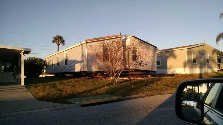 At the close of Monday, Dec 15th, 2014 the two sections of the Palm Harbor home had been pushed into the 710 lot at Golf Lakes, Bradenton, Florida. They were still wrapped up and weather tight until they were pulled together and sealed.
