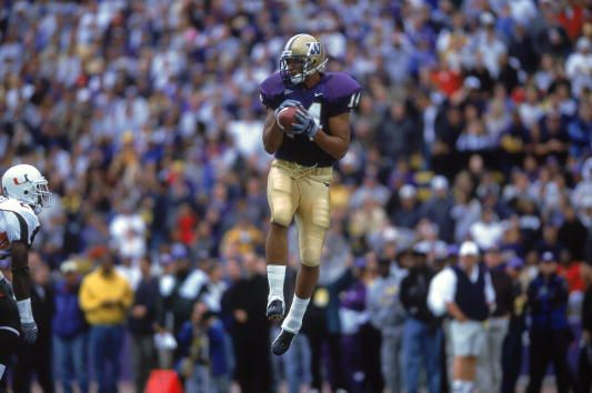 Jerramy Stevens of the Washington Huskiesleaps up to catch the ball during the game against the Miami Hurricanes at the Husky Stadium in Seattle...