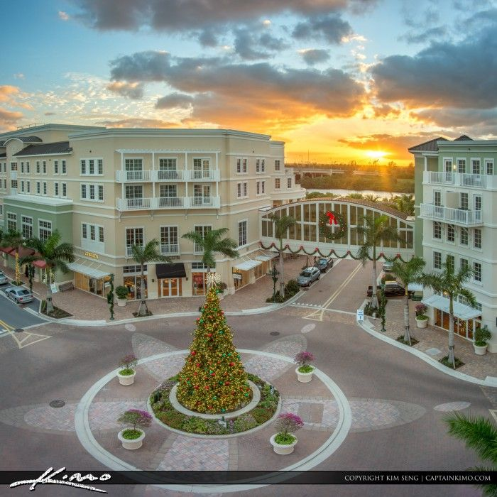 Sunset at Harbourside shopping plaza and restaruants in Jupiter Florida with Christmas Tree at circle. HDR tone mapped in Photomatix and Topaz software.