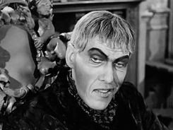 lurch addams family trying a smile reaction gif