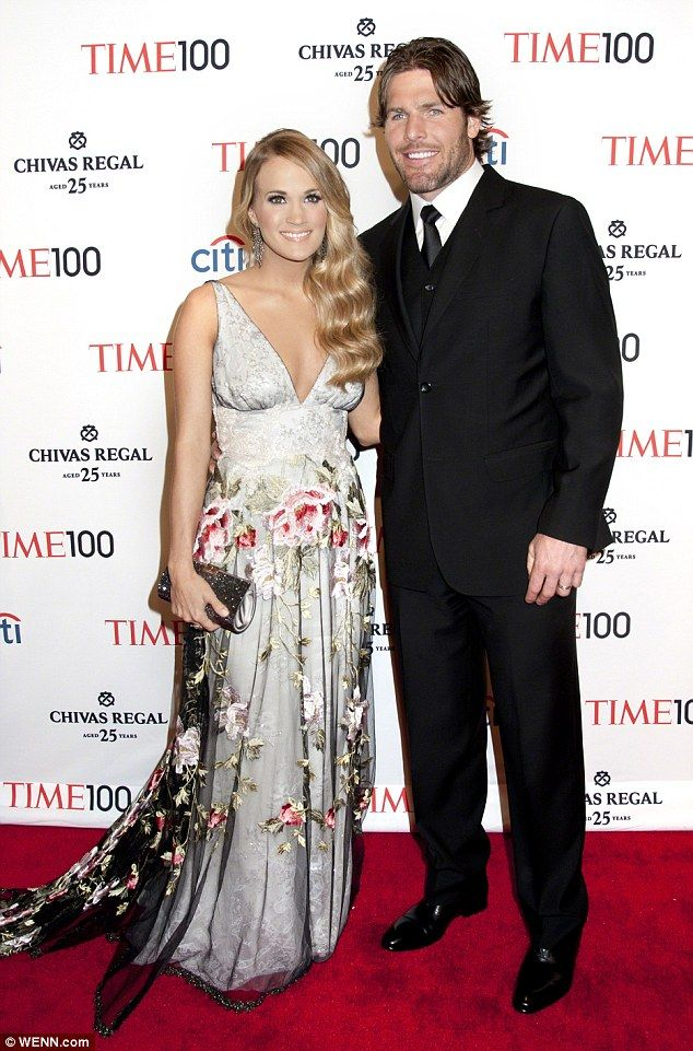 Carrie Underwood and husband Mike Fisher, married in 2010, on the Red Carpet for TIME 100 event in 2014. Love the overskirt on her dress...