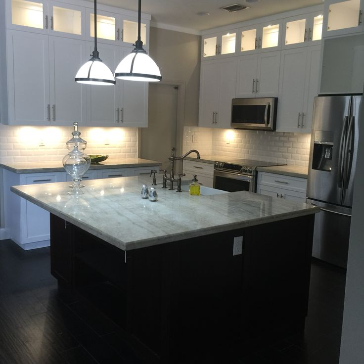 White Shaker Style Cabinets With An Expresso Island