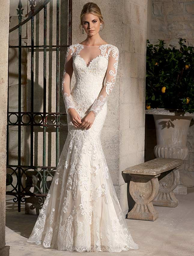Majestic Embroidered Appliques Combined with Chantilly Lace adorn this fishtail wedding dress with long slim sleeves and illusion high neck line at the front and back. Available in Three Lengths: 55 inches, 58 inches, 61 inchesAvailable in White, Ivory, Gold