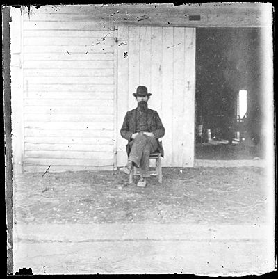 Citation: John Smith seated outdoors (unfocused), ca. 1895 / unidentified photographer. John Frederick Peto and Peto family papers, Archives of American Art, Smithsonian Institution.
