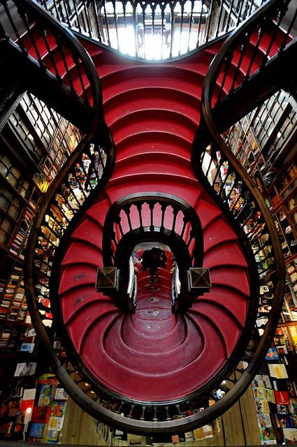 The Lello bookstore in Porto, Portugal - open since 1906......... This would also be a necessary staircase if I were ever to build a dream home