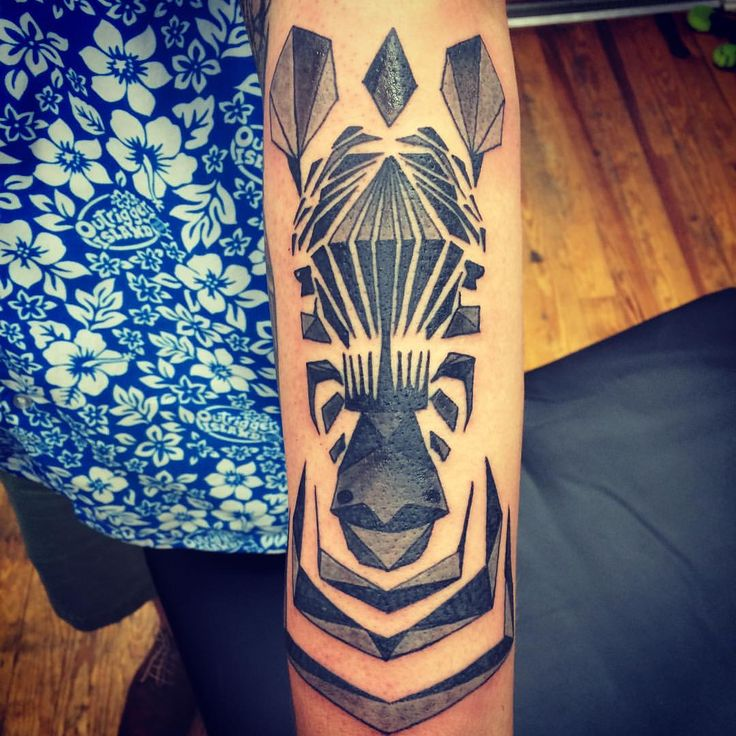 Geometric zebra tattoo by @chriskelleytattoos
